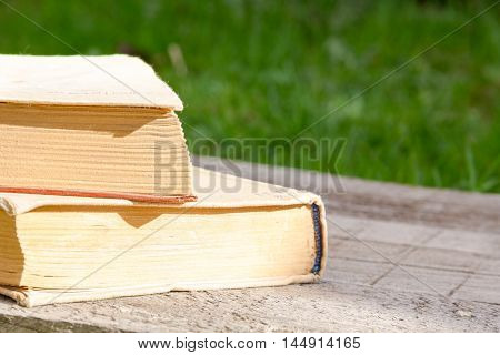 Old hardcover books selective focus. Education concept on wooden background. to learn foreign languages. the remote training. Back to school background with copy space for text ads. exam preparation