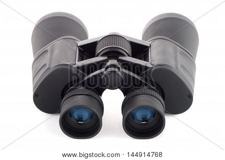 Closeup of black binoculars isolated on white background.