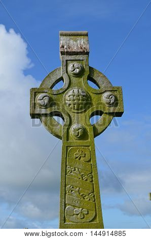 Gorgeous stone celtic cross in Ireland against the sky