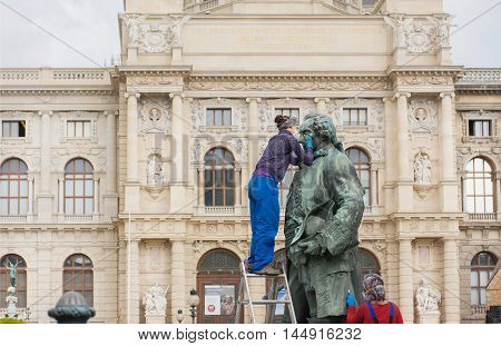 VIENNA, AUSTRIA - JUN 10, 2016: Workers cleaning ancient monuments at front of Kunsthistorisches Museum on June 10, 2016. Museum of Art History was opened in 1891.