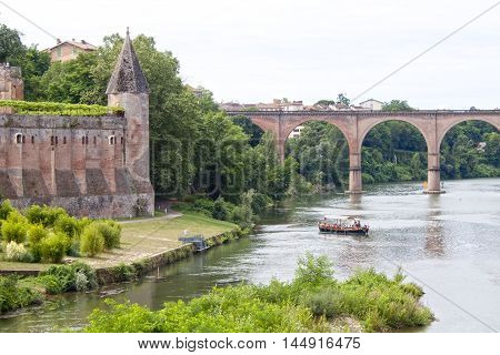 Berbie Palace And A Boat Sailing In Tarn River In Albi, France