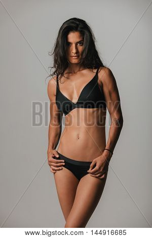 Attractive Sultry Young Woman In Black Underwear