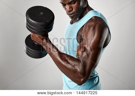 African Fitness Model Exercising With Heavy Dumbbells