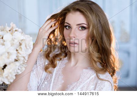 Female Portrait Of Cute Lady In Robe Indoors. Close Up Beautiful Sexy Model Girl In Elegant Pose. Cl