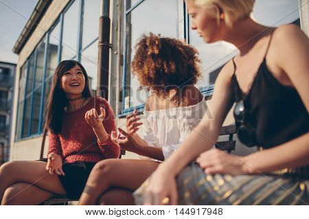 Female Friends Sitting Outdoors And Talking