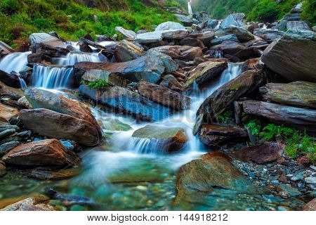 Cascade of tropical waterfall in Himalayas. Bhagsu, Himachal Pradesh, India. Polarizer filter used