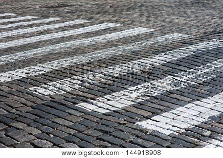 Zebra - pedestrian road crossing area in city.