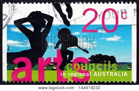 AUSTRALIA - CIRCA 1996: a stamp printed in Australia shows Silhouettes of Ballet Dancer and Violinist Arts Councils in Regional Australia circa 1996