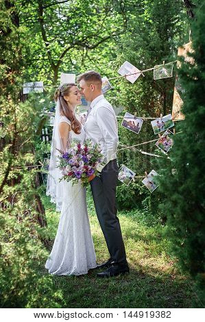bride and groom are in the blossoming spring garden.