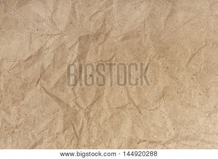 Brown and crumpled background with recycled paper