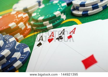 poker four aces on green casino table