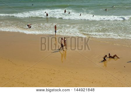 ALBUFEIRA, PORTUGAL - AUGUST 25, 2016: People at the famous beach Gale in Albufeira. This beach is a part of famous tourist region of Algarve.