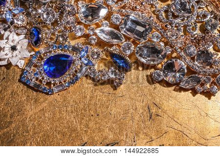 Luxury precious beautiful jewelry on golden shiny background
