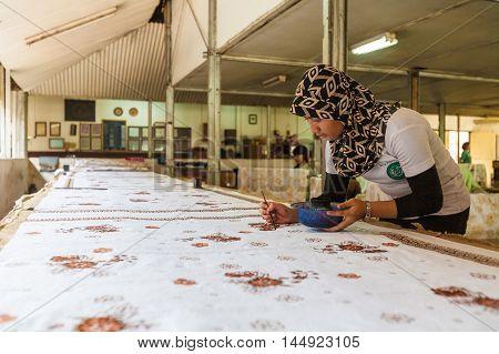 Yogyakarta, Indonesia - August 28, 2008: Woman Painting Wax At Batik Factory