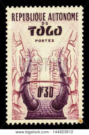 Togo - CIRCA 1957: A stamp printed in Togo shows togo traditional headdress, circa 1957