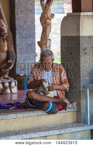 Ubud, Indonesia - August 29, 2008: Native Man Carving Wooden Statue For Souvenir Shop