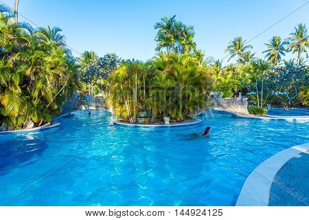 Bali, Indonesia - August 29, 2008: Tourists Swimming In Enormous Exotic Pool
