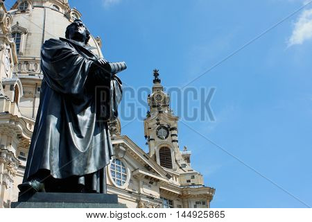 Martin Luther monument in front of Frauenkirche cathedral in Dresden Germany.