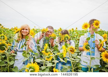 Happy Family Having Fun On Sunflowers