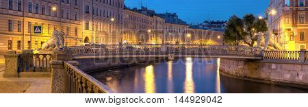 Night view on illuminated Griboedov Canal and Lions Bridge St. Petersburg Russia