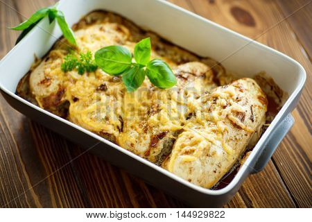 chicken baked with cheese and spices in a ceramic form