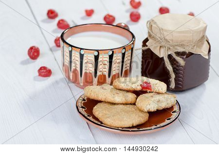 Tasty breakfast Oatmeal cookies with milk and jam