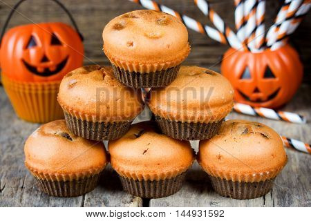 Halloween chocolate pumpkin muffins for trick or treat night selective focus