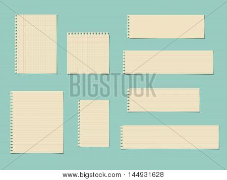 Pieces of cut yellow squared, ruled notebook paper are stuck on blue background.