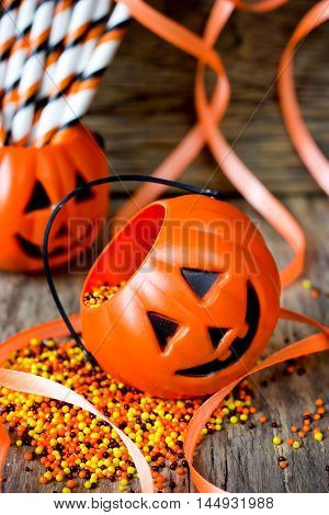 Halloween Jack-o-Lantern with candy corn color sugar sprinkling. Halloween trick or treat night decoration selective focus