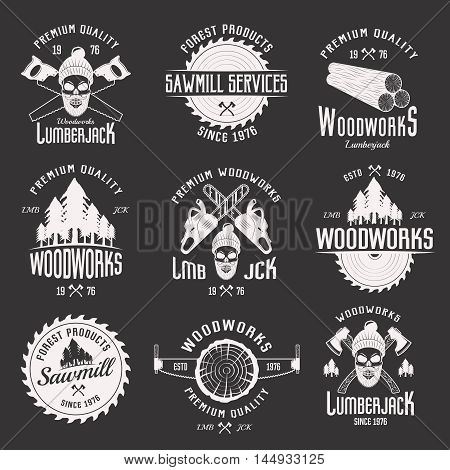 Woodworks monochrome emblems of sawmill and lumberjack services with working tools on black background isolated vector illustration