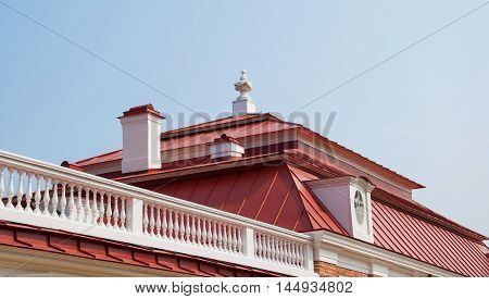 old roof with chimneys, with tower and loft