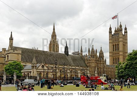 LONDON ENGLAND - JULY 8 2016: Houses of Parliament Westminster Palace seen from the Parliament square. It is one of London's top tourist attractions.