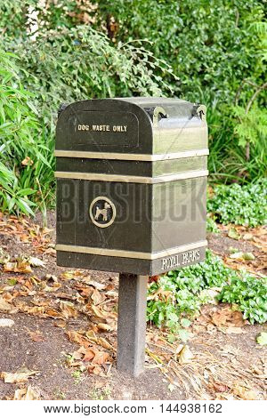 Dog waste urn in London park England.