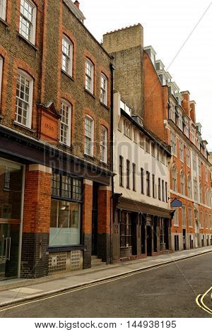 Street with traditional red brick houses in central London England.