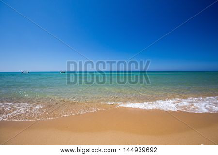 Turquoise crystal clear water. Long sandy beach between Eraclea Minoa and Torre Salsa, Sicily, Italy