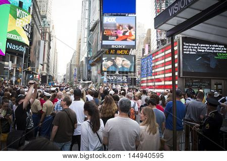 NEW YORK MAY 27 2016: Navy Band Northeast Rhode Island Sound perform a public concert next to the Armed Forces Recruiting Station on the Pedestrian Plaza in Times Square during Fleet Week NY 2016.