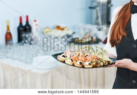 Catering waitress service. woman at restaurant event
