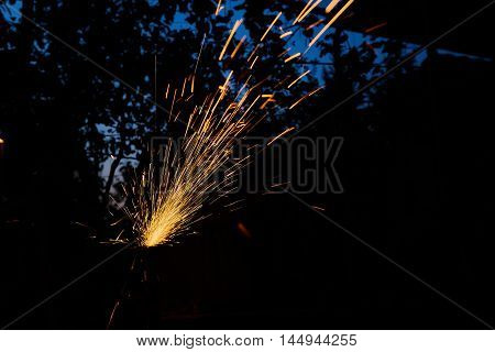 Worker cutting metal with grinder. Sparks while grinding iron.