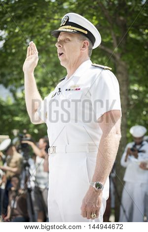 NEW YORK MAY 27 2016: Admiral Phil Davidson, Commander US Fleet Forces Command, swears in personnel during the re-enlistment and promotion ceremony at the National September 11 Memorial site.