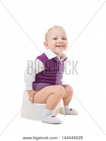 A child sitting on a pot isolated on white background