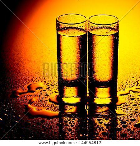 A row of glasses for vodka. studio shot