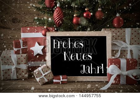 Nostalgic Christmas Card For Seasons Greetings. Christmas Tree With Balls And Snowflakes. Gifts In The Front Of Wooden Background. Chalkboard With German Text Frohes Neues Jahr Means Happy New Year