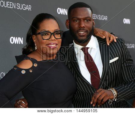 LOS ANGELES - AUG 29:  Oprah Winfrey, Kofi Siriboe at the Premiere Of OWN's
