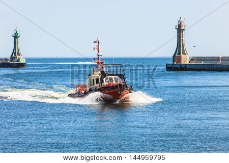Small Vessel Returning To Port.
