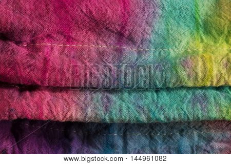 Tie dye style dyed textile. close-up.