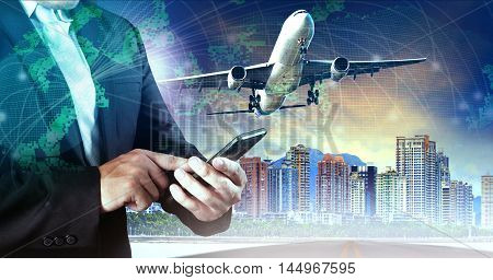 business man touching on smart phone and air plane flying mid air against city building and world map network