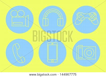 Gadget minimal icons yellow on blue. Hand-drawn vector illustration. Outlined pictures of video camera photo camera earphones smartphone phone player joystick. Internet technology concept image