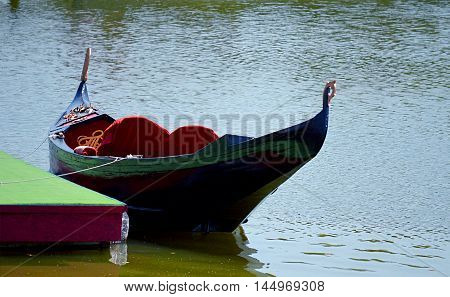 walking for two decorated boat on the river