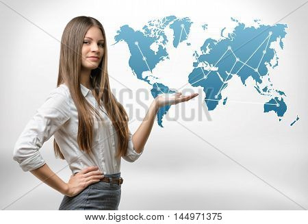 Cropped portrait of young businesswoman raised her hand presenting world map. Global communication. International relations. Business staff.