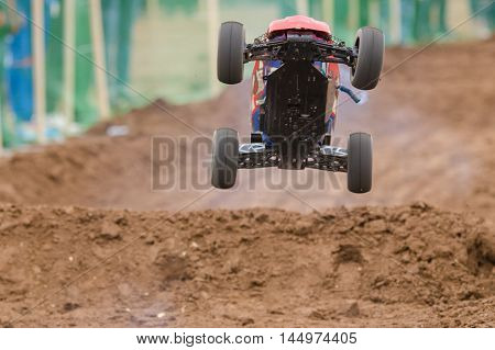 Volgograd, Russia - April 19, 2015: Radio-controlled Machine With A Combustion Engine Has Jumped On